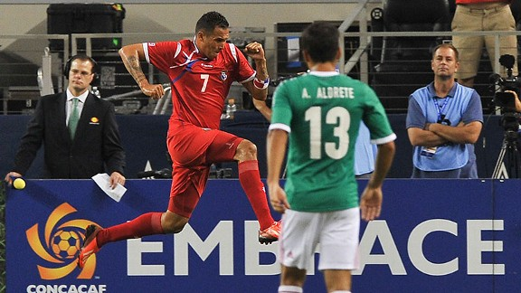 Mexico's Adrián Aldrete watches on as Blas Perez celebrates his goal.