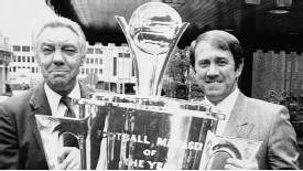 Everton manager Howard Kendall is presented with the Manager of the Year trophy by the previous winner, Liverpool's Joe Fagan, in 1985