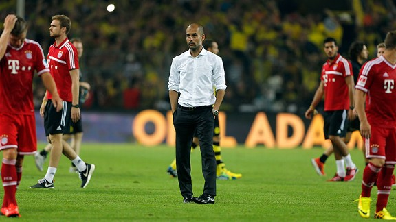 Pep Guardiola cuts a lonely figure after Bayern Munich's German Supercup loss to Borussia Dortmund