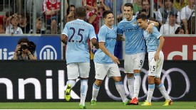 Manchester City players celebrate Alvaro Negredo's goal against Bayern Munich.