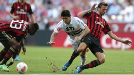 AC Milan's Bryan Cristante (R) and Jherson Vergara (L) battle for the ball in the Audi Cup.