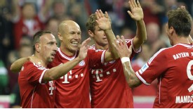 Bayern Munich players celebrate during their Bundesliga win against Borussia Monchengladbah.