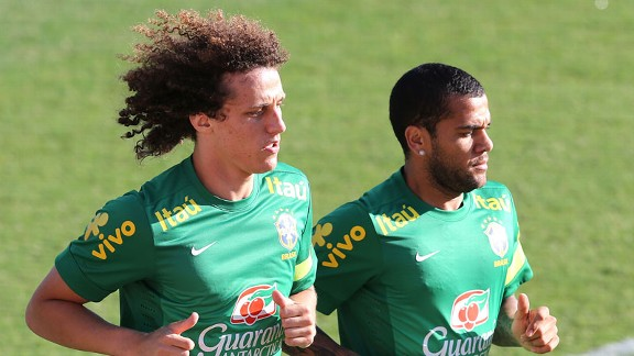 Chelsea's David Luiz alongside Barcelona's Dani Alves.