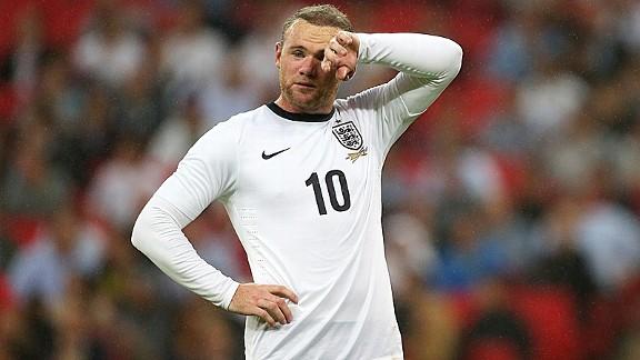 Wayne Rooney finds it tough going against Scotland