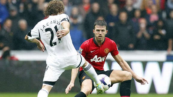 Michael Carrick keeps a close eye on Swansea debutant Jose Canas.