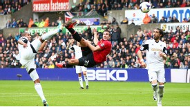 Robin van Persie acrobatically puts Manchester United in front at Swansea.