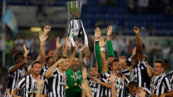 Juve captain Gianluigi Buffon lifts the Supercoppa trophy.