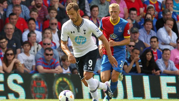 Roberto Soldado in action for Tottenham, closely watched by Dean Moxey.