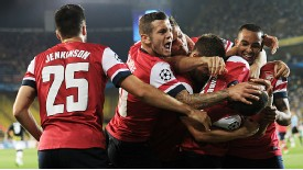 Arsenal celebrate Aaron Ramsey's goal which put the Gunners two up