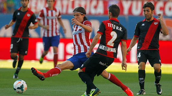 Atletico cruised to a 5-0 win in their traditional stripes over Rayo Vallecano.