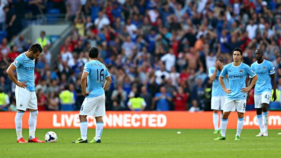 Dejected Man City players look on as they head towards a 3-2 defeat in Cardiff.