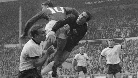 Hans Tilkowski clashes with Geoff Hurst in the 1966 World Cup final.