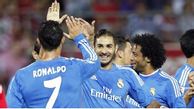 High fives among the Real Madrid players after Karim Benzema's early goal against Granada