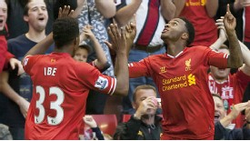 Jordan Ibe celebrates with goalscorer Raheem Sterling.