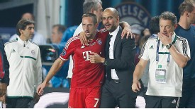 Pep Guardiola (R) celebrates with Franck Ribery after Bayern's win.