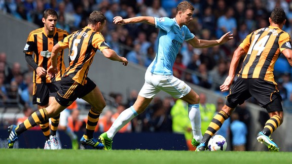 Edin Dzeko is crowded out during Manchester City's game against Hull.