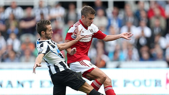Yohan Cabaye (L) and Alex Kacaniklic (R) battle for the ball in Newcastle's win.