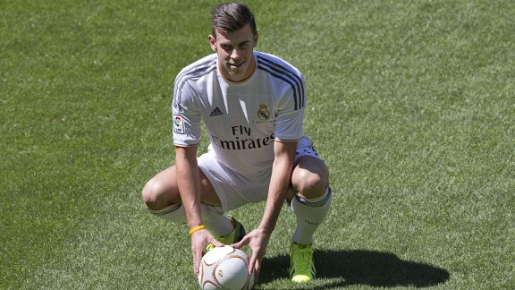 Gareth Bale poses on the Bernabeu pitch after signing for Real Madrid.