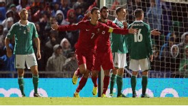 Cristiano Ronaldo celebrates after netting his second goal against Northern Ireland.