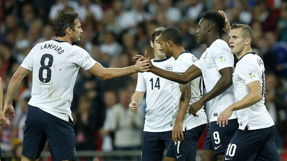 Danny Welbeck celebrates after putting England into a 4-0 lead.