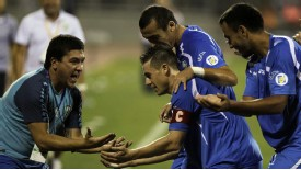 Uzbekistan captain Server Djeparov (C) celebrates after equalising against Jordan.