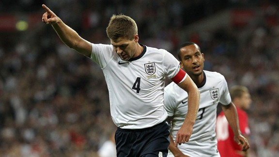 Steven Gerrard celebrates giving England the early lead.