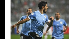 Luis Suarez scored twice as Uruguay got their qualification campaign back on the right road.