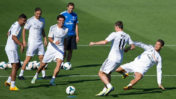 Cristiano Ronaldo sticks one on Gareth Bale in training.
