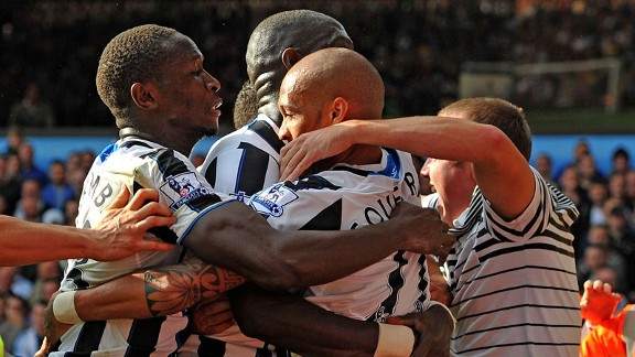 Yoan Gouffran is mobbed by fans and team-mates after restoring Newcastle's lead.