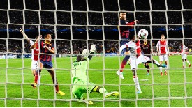 Gerard Pique heads home Barcelona's third goal against Ajax.