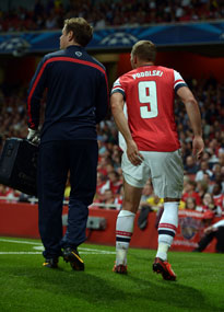 Lukas Podolski was injured playing for Arsenal against Fenerbahce.