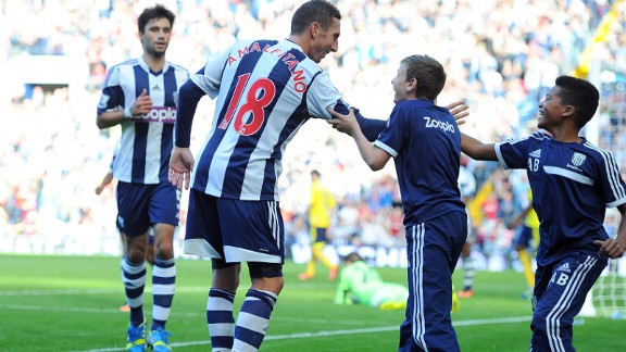 Morgan Amalfitano celebrates scoring West Brom's third goal.