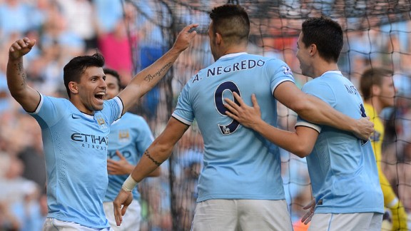 Sergio Aguero celebrates with his team-mates after netting City's third goal.