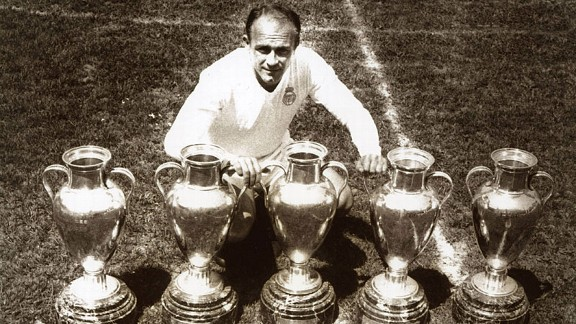 Alfredo Di Stefano poses with the five European Cups he won.