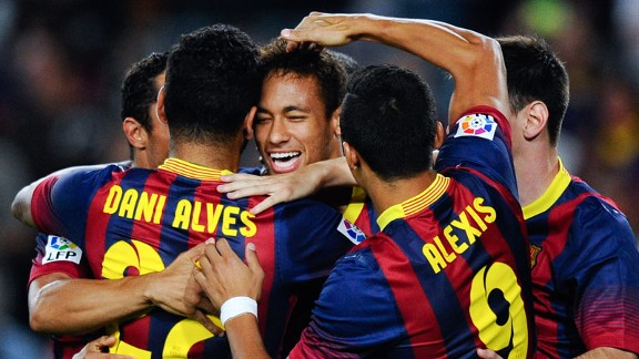 Neymar celebrates with his Barcelona team-mates after opening the scoring.