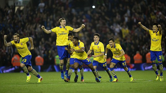 Arsenal celebrate Nacho Monreal's match-winning penalty.