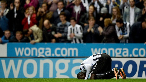 Papiss Cisse kisses the turf after giving Newcastle the lead against Leeds.