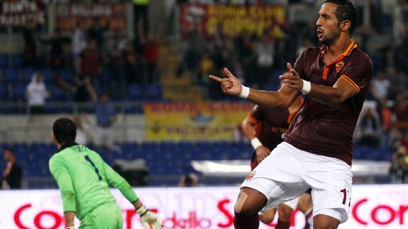 Roma's Mehdi Benatia his goal against Bologna.
