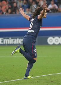 Edinson Cavani wheels away after hitting the back of the net for PSG against Toulouse.