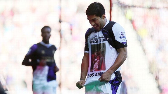 Luis Suarez pays tribute to his new son after netting the first of his two goals against Sunderland.