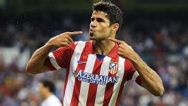 Diego Costa celebrates after he scored the winner in the Madrid derby.