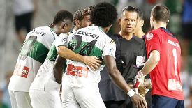 Elche players surround referee Muniz Fernandez after he gifted Real Madrid a 96th-minute penalty on Wednesday evening.