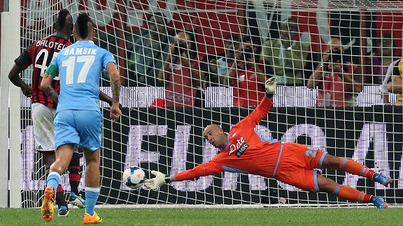 Napoli keeper Pepe Reina saves a penalty by AC Milan's Mario Balotelli.