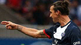 Zlatan Ibrahimovic appears to make a gun gesture towards the Toulouse bench.