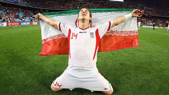 Andranik Teymourian of Iran celebrates qualifying for the 2014 FIFA World Cup