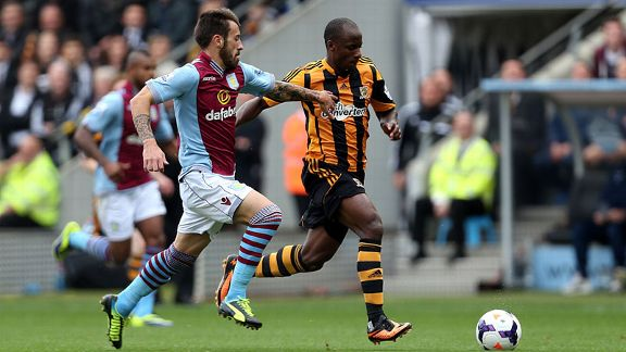 Antonio Luna battles with Sone Aluko during Aston Villa's Premier League game against Hull.