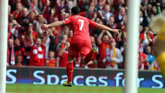 Luis Suarez wheels away after opening the scoring for Liverpool against Palace.