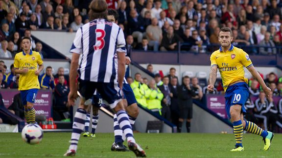 Arsenal's Jack Wilshere scores against West Bromwich Albion.