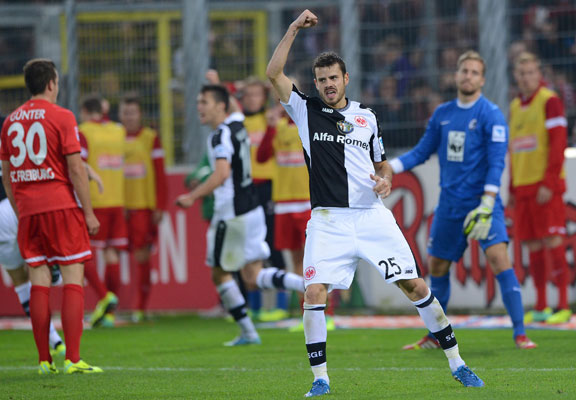 Tranquillo Barnetta celebrates after Eintracht Frankfurt take the lead through Christian Guenter's own goal.