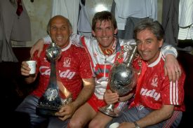 Kenny Dalglish celebrates Liverpool's last league title, in 1990, with Ronnie Moran and Roy Evans.